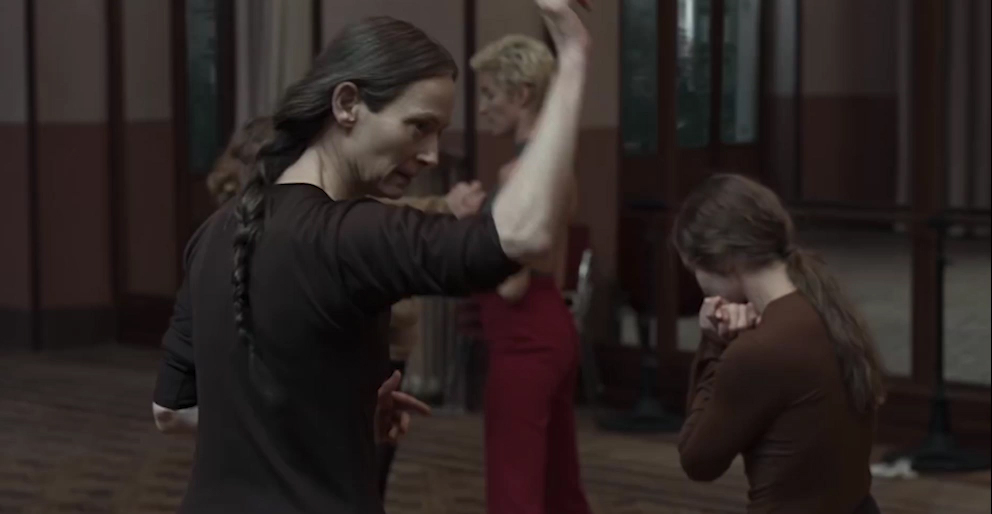 Tilda Swinton as Mme Blanc, strictly instructing her dance class.