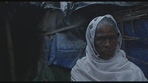 An old woman in Kutupalong-Camp in Ukhia, Bangladesh. From HUMAN FLOW, an Amazon Studios release. Photo courtesy of Amazon Studios.