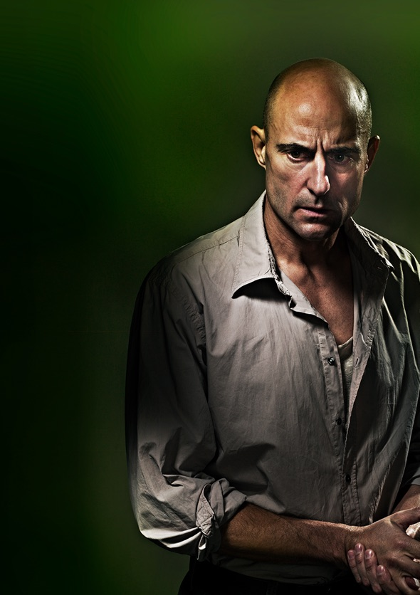 Show image of Mark Strong as Eddie Carbone in a white shirt.