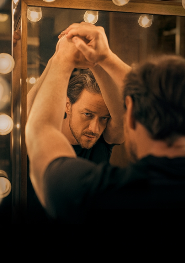 Show image of James McAvoy as Cyrano de Bergerac looking into his reflection in a dressing room mirror.