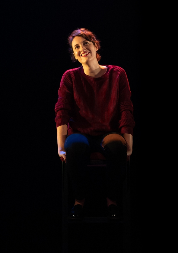 Production photograph of Phoebe Waller-Bridge as Fleabag sitting on a chair.