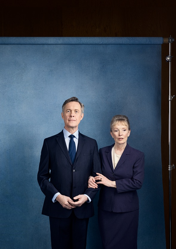 Show image of Lindsay Duncan and Alex Jennings as Diana and Robin Hesketh standing together with arms linked posing for a photograph.