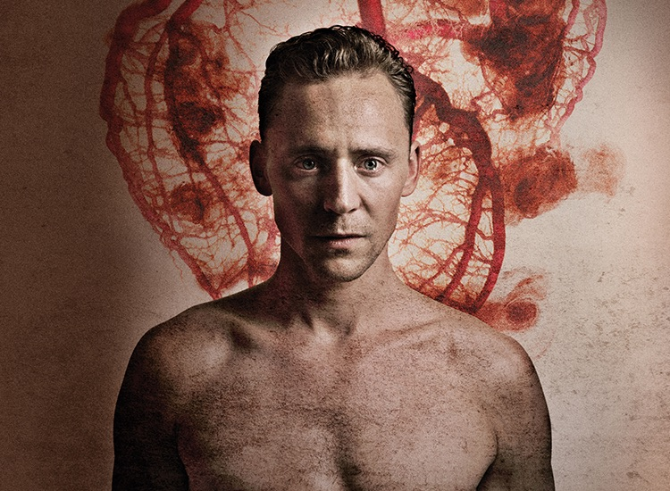 Show image of Tom Hiddleston as Coriolanus in front of a background picturing veins.