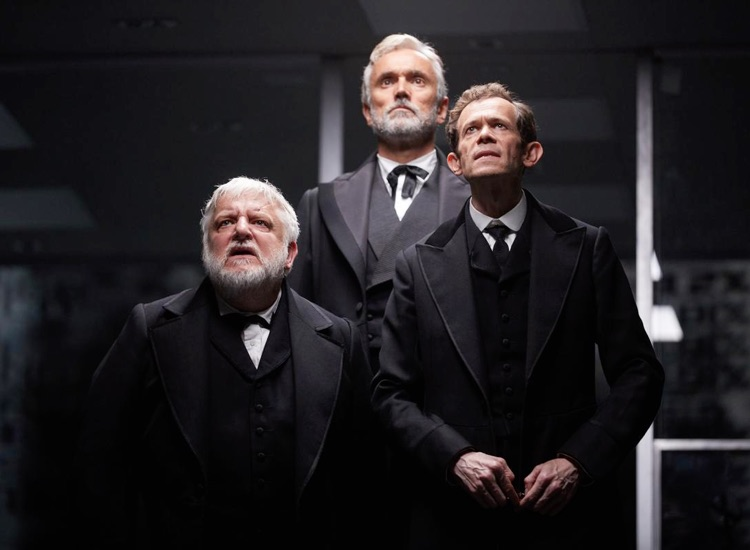 Production image of the Lehman brothers in black suits, played by Simon Russell Beale, Adam Godley and Ben Miles