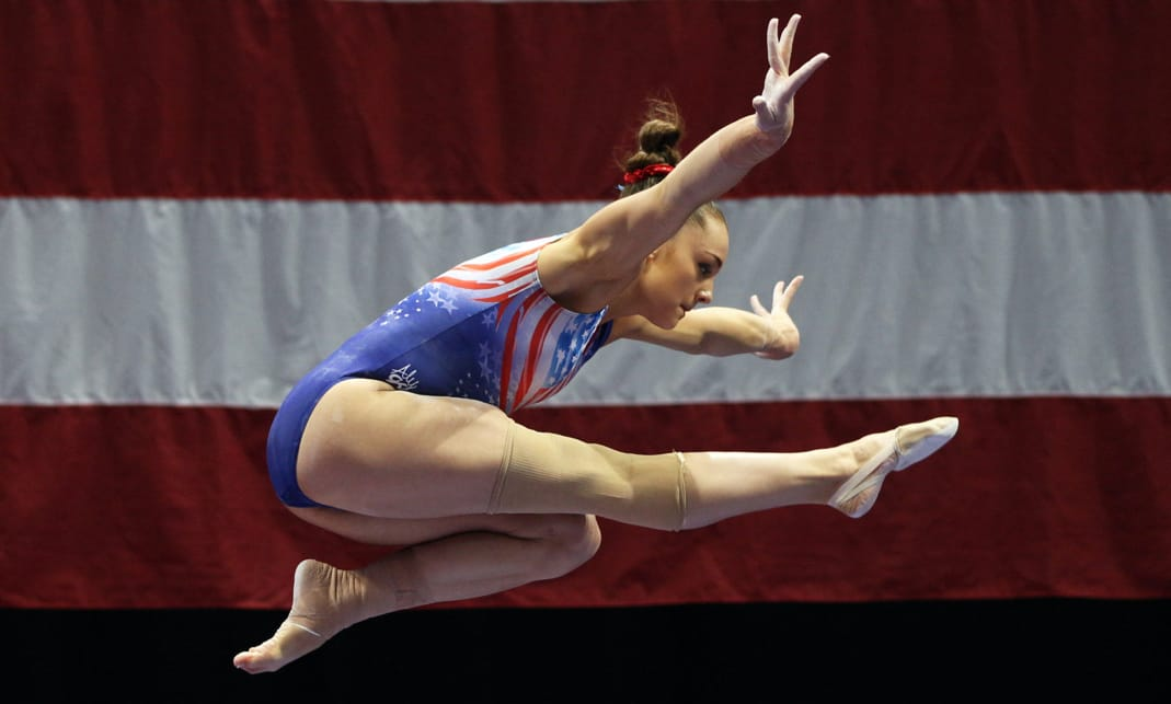Nichols flies in front of an American flag.