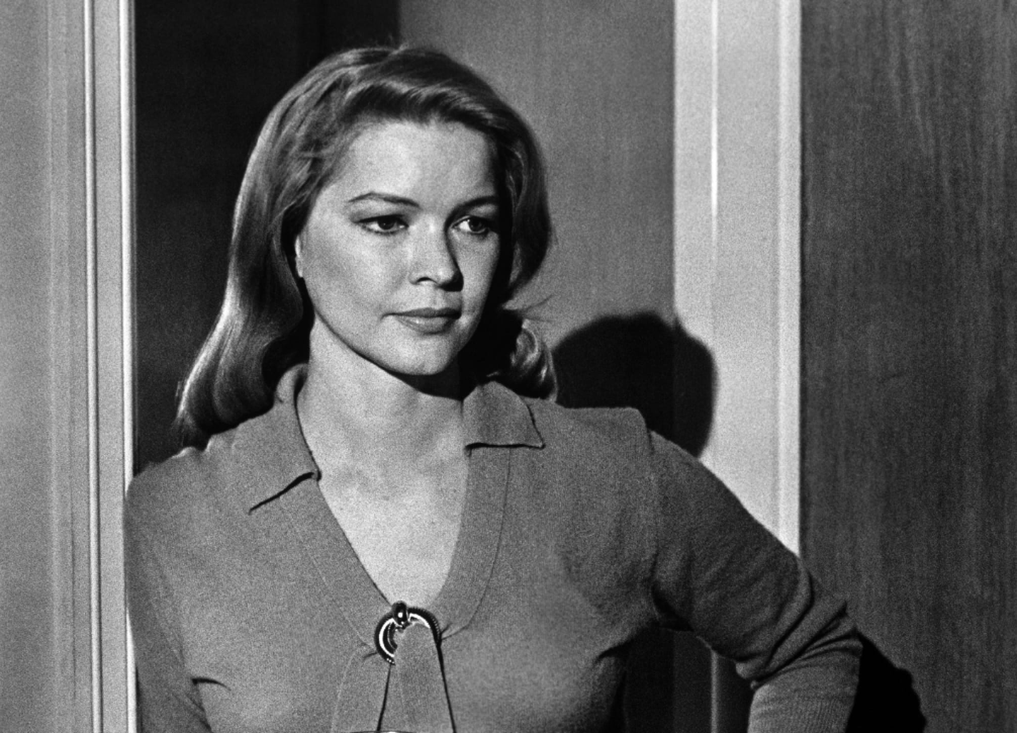 Ellen Burstyn as Lois Farrow in a still from The Last Picture Show. Burstyn was in her 30s when this film was shot. Here she appears posed in a doorway, hand on her hip.