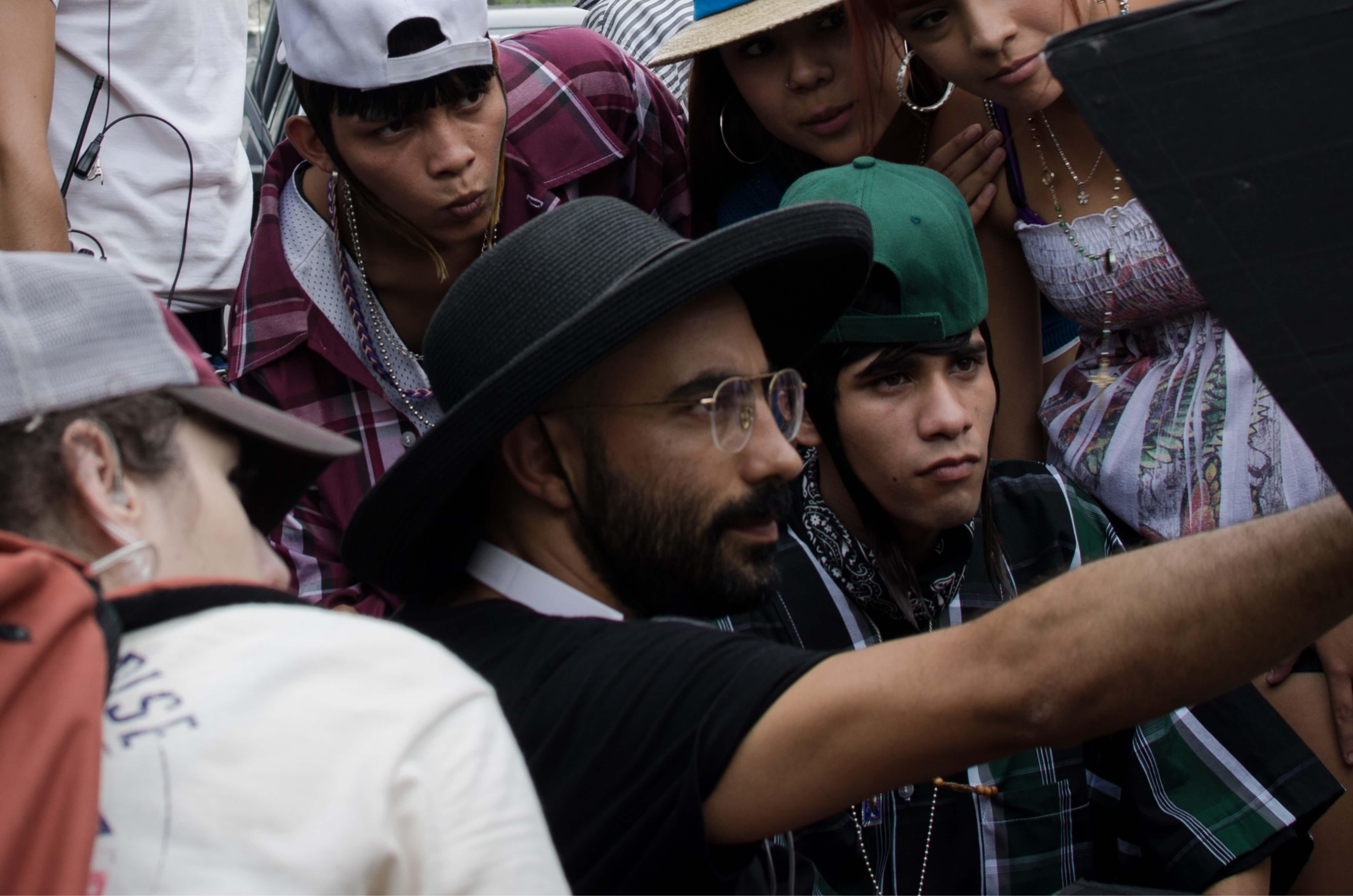 Fernando Frías de la Parra reviews footage with the cast of <i>Ya no Estoy Aquí.</i>