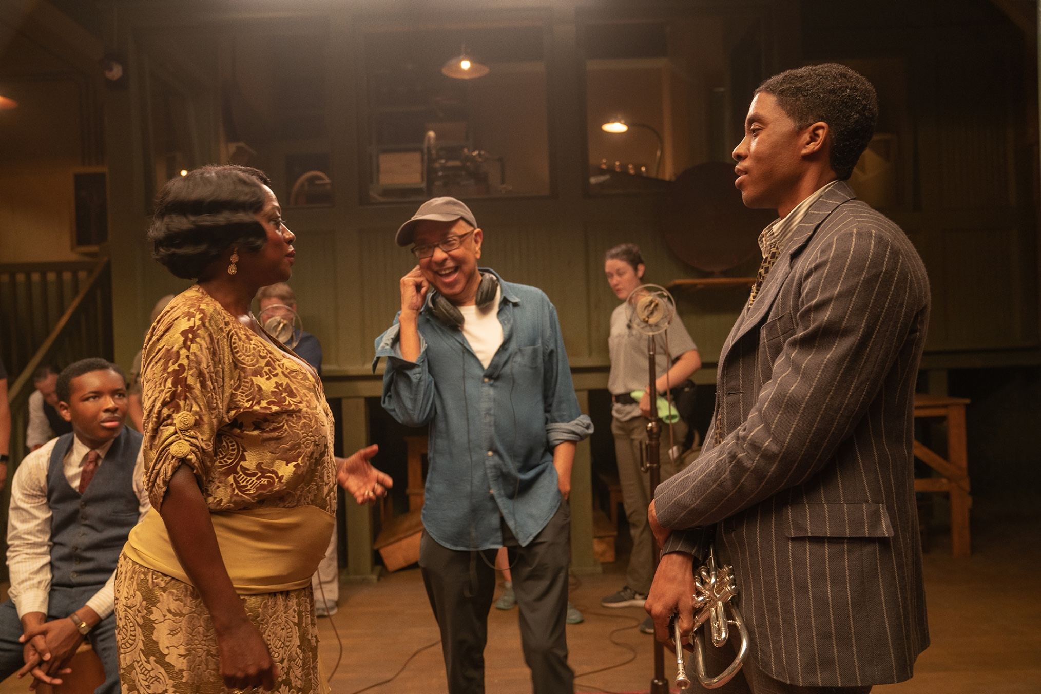 George C. Wolfe directs Viola Davis, looking glamorous in a drapey gold number, and Chadwick Boseman, dapper in pinstripes, in between takes of Ma Rainey's Black Bottom.
