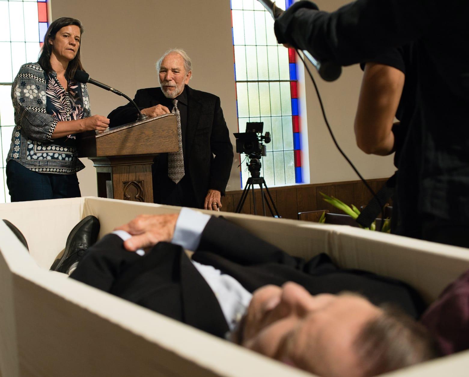 Kirsten Johnson surveys Dick Johnson in his casket