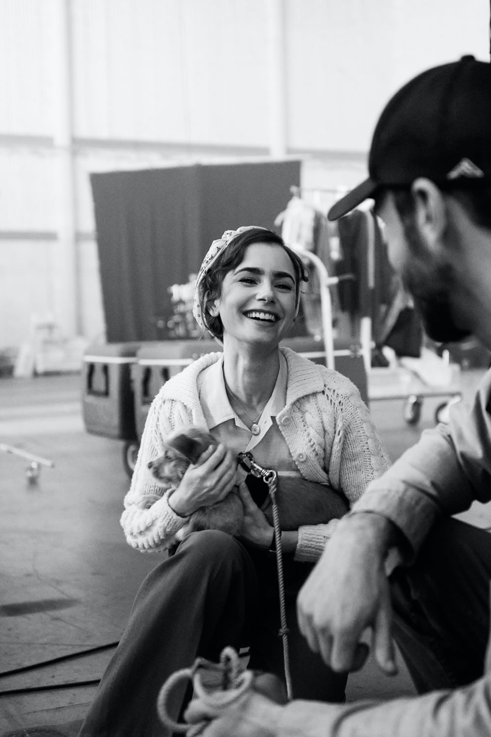 Lily Collins looking straight out of 1930s Hollywood between scenes.