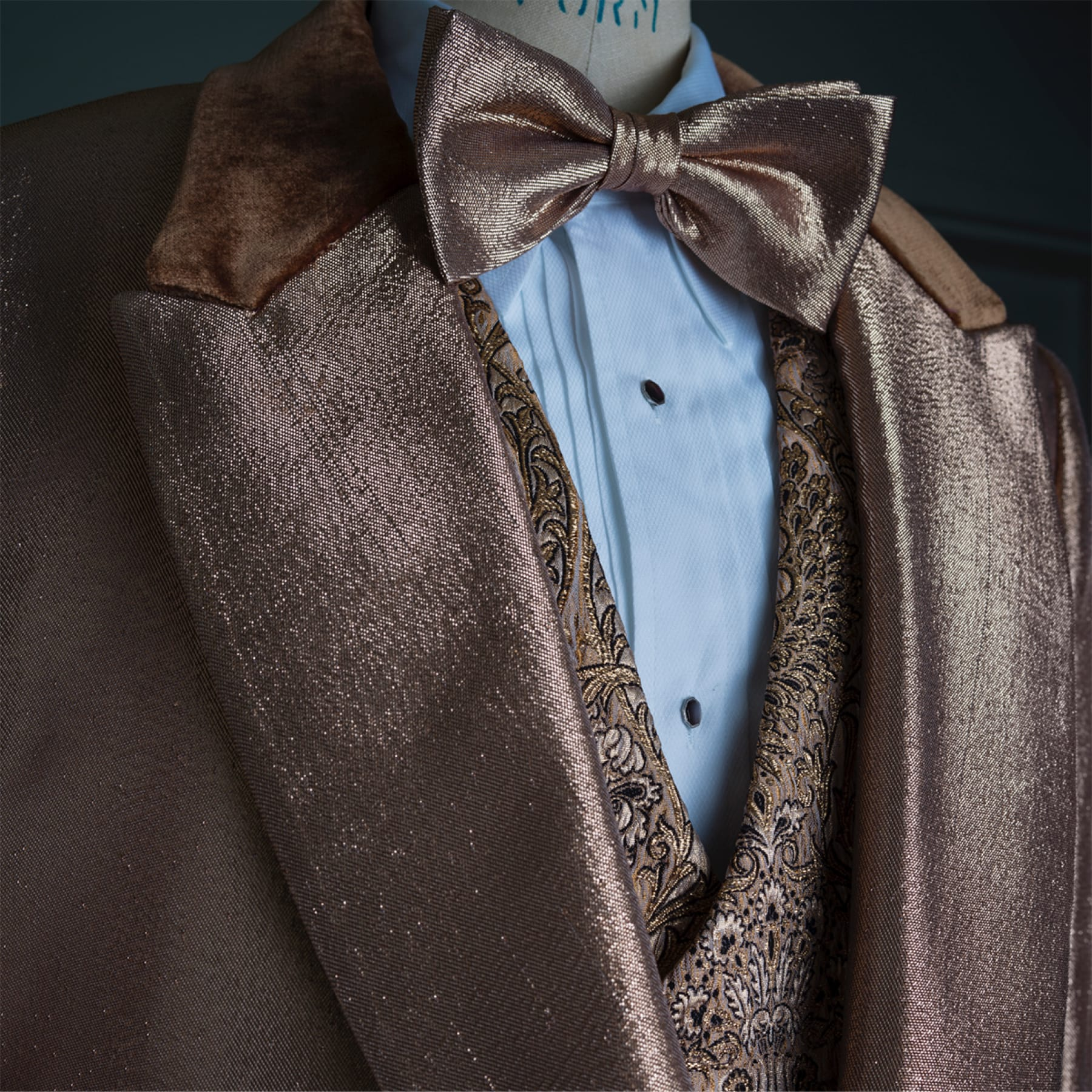 William Randolph Hearst's (Charles Dance) shiny, bronze suit and bowtie.