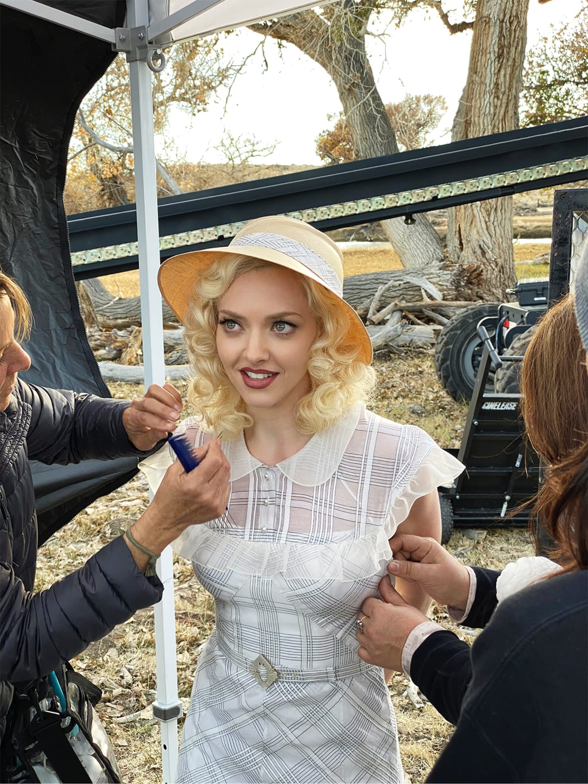 Amanda Seyfried in costume. She has straw-yellow locks, which are being combed as we speak, and is wearing a white dress, which appears to be getting it's final alterations.