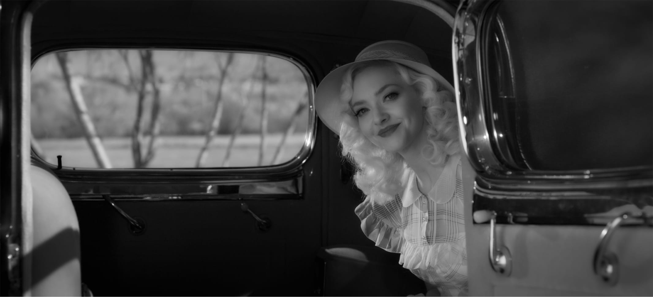 In a shot from the film, we see how all that work pays off. Seyfried's dress is all pleasant frills and her hair falls in soft tresses.