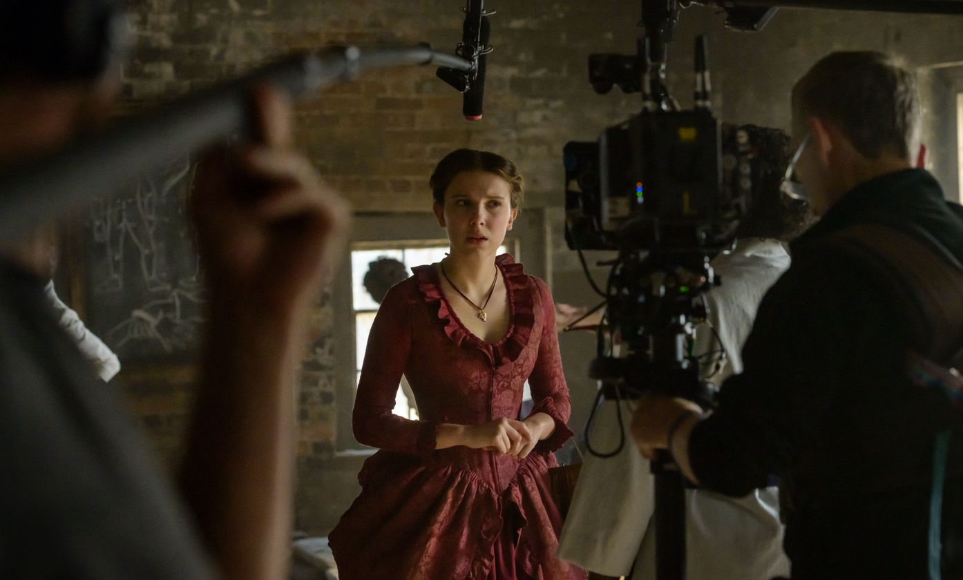 Millie Bobby Brown on the set of *Enola Holmes*