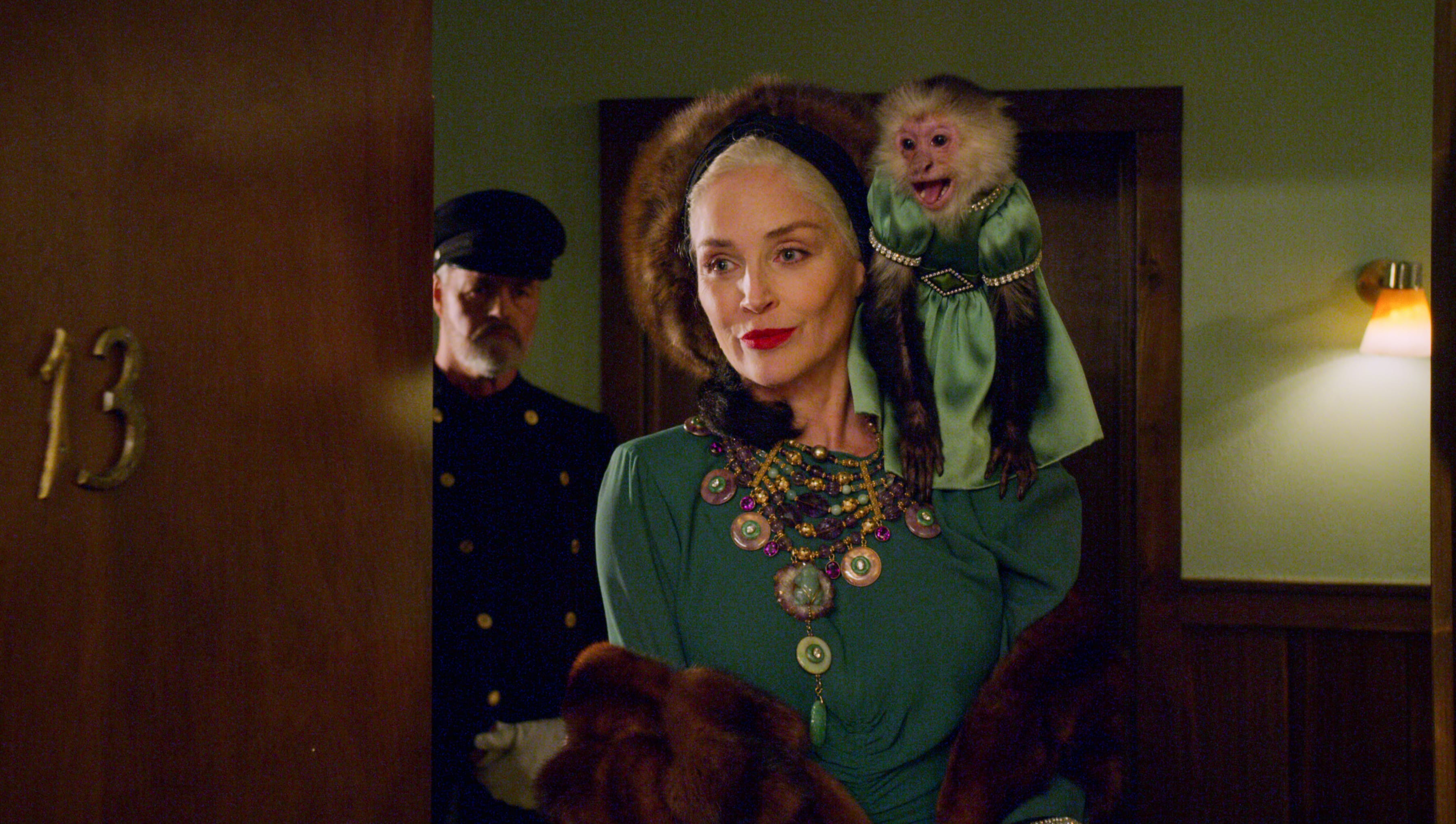 Lenore Osgood is pictured in a green dress and furs, all perfectly coordinated to match the monkey perched on her shoulder.