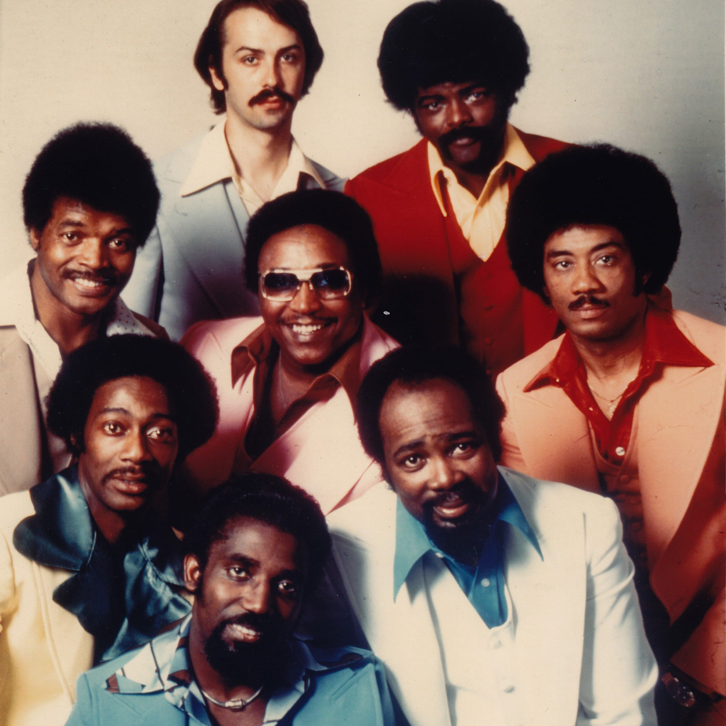 The Fatback Band in a posed photograph. Oh, the pastel, wide-lapel suits! Oh, the mustaches on every single one of them!