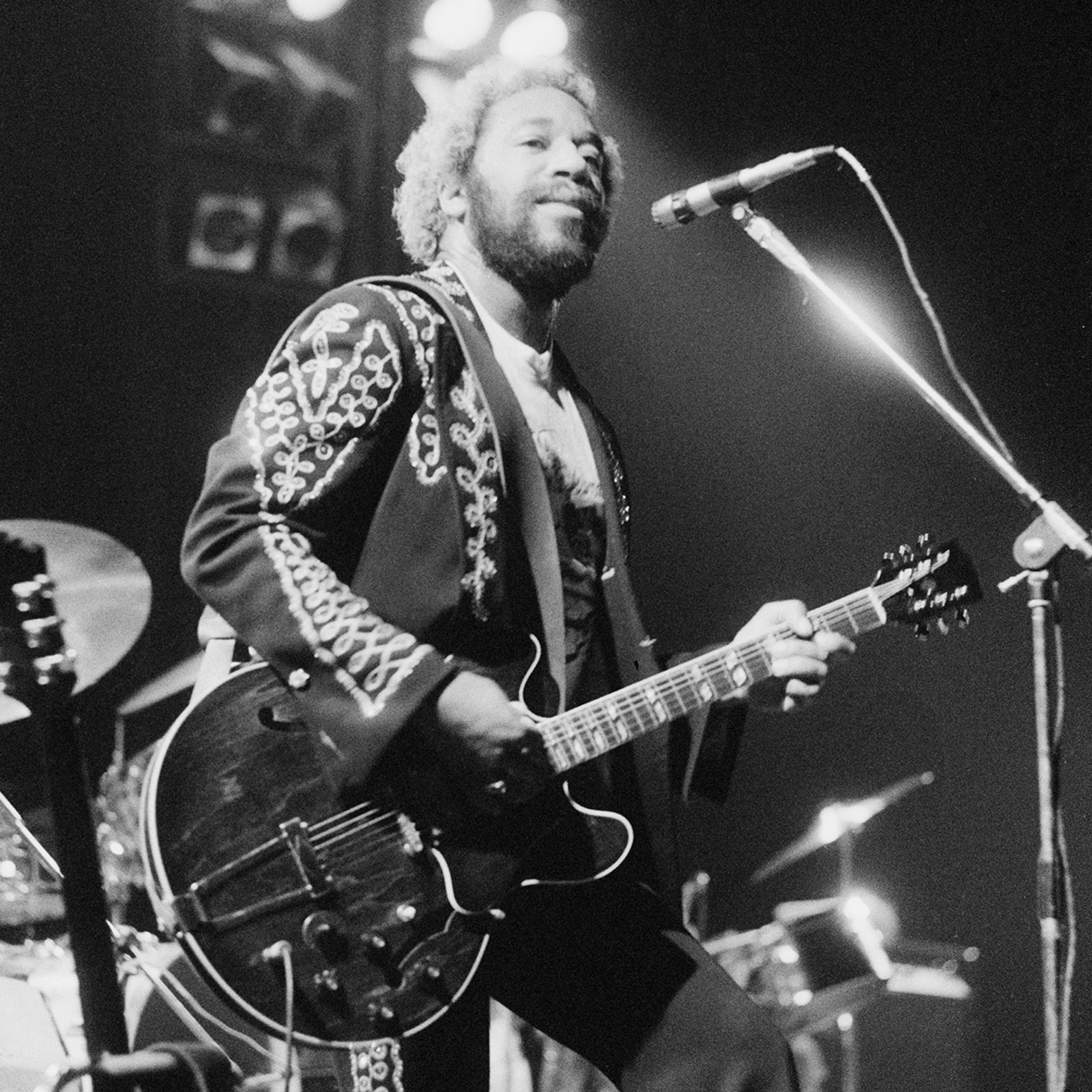 Guitarist Howard E. Scott performing with American funk band, War, at the Hammersmith Odeon, London, 22nd June 1976.