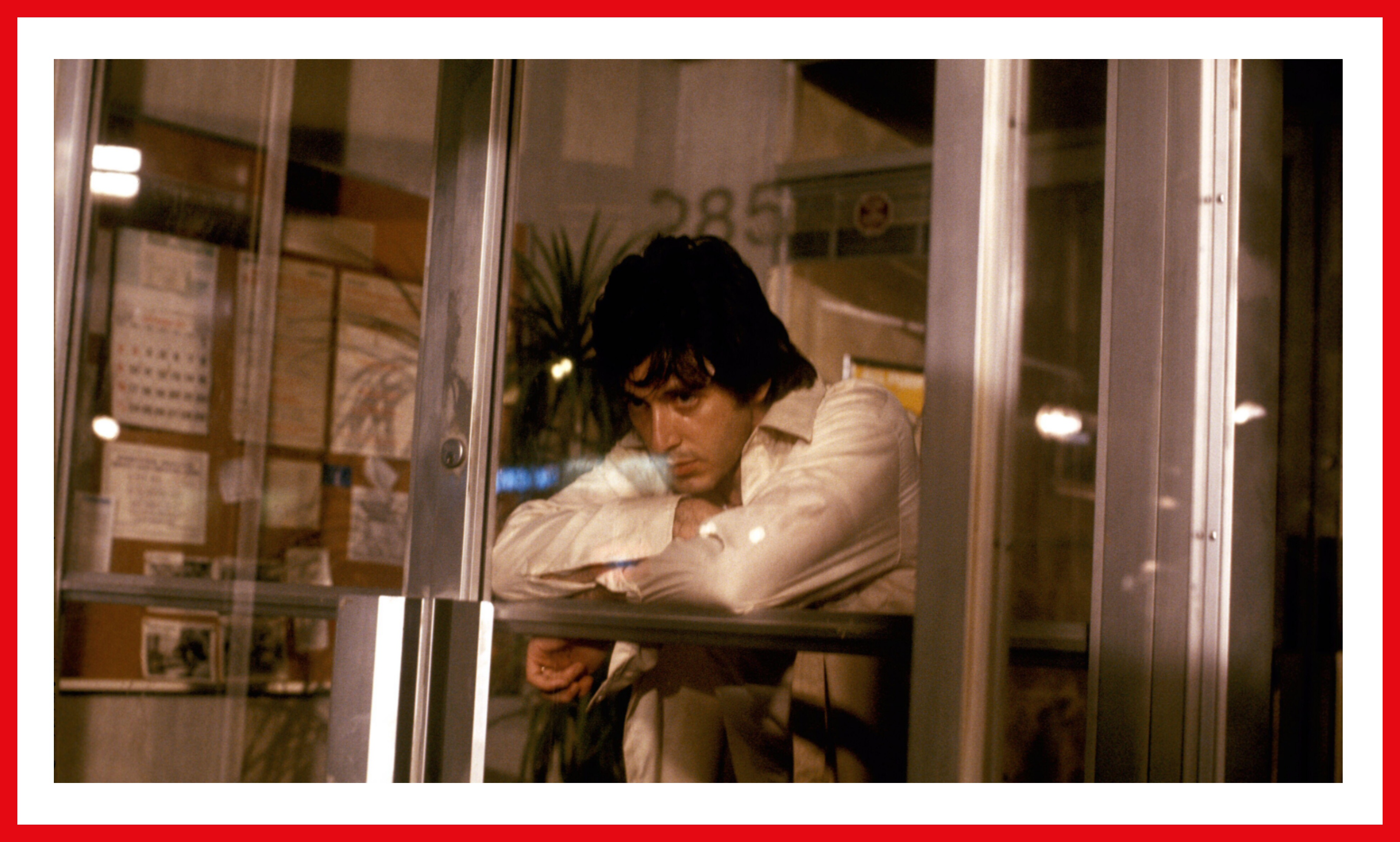 Pacino as Sonny, looking trapped inside the bank he's trying to rob.