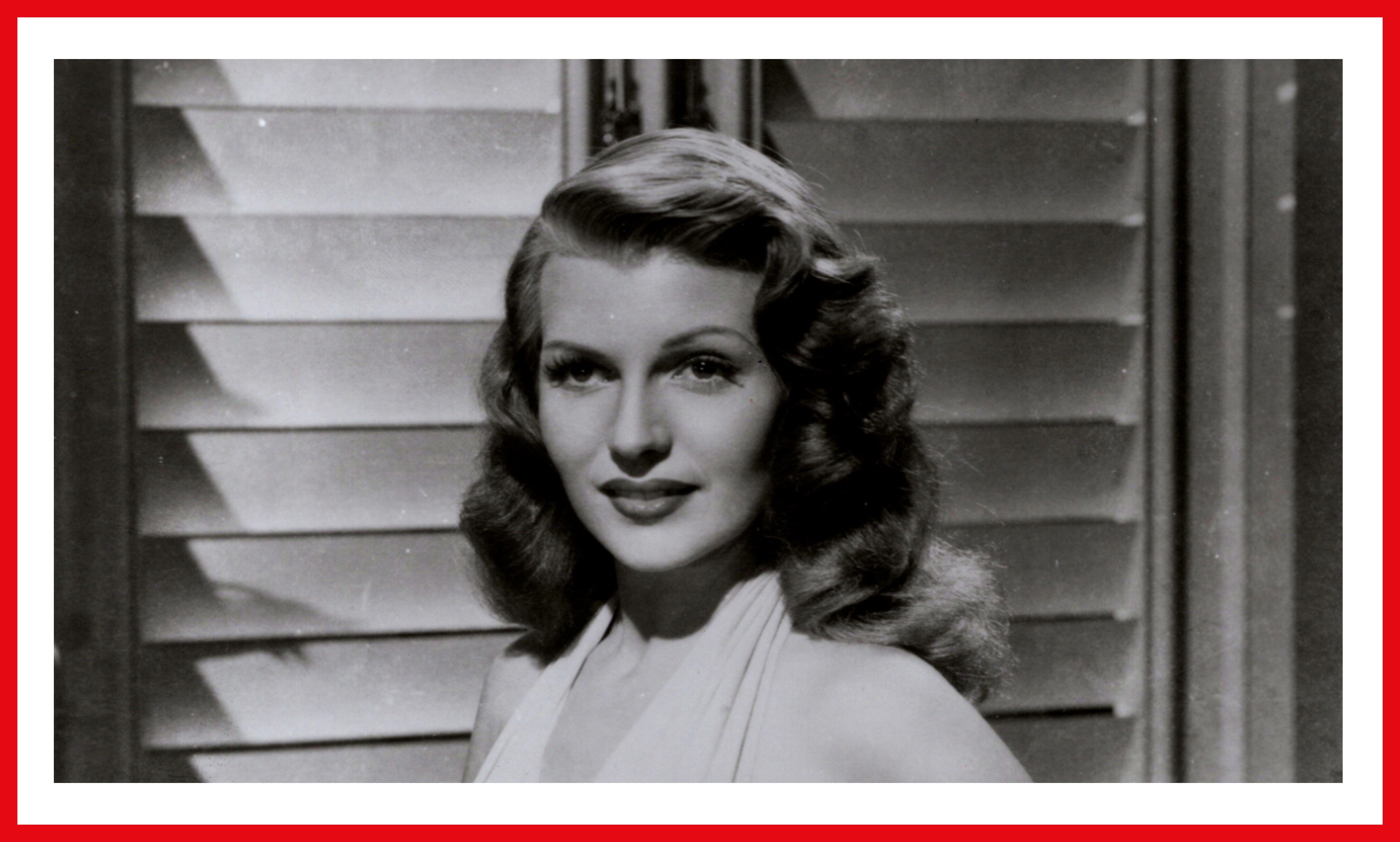 Hayworth as the title character, looking glamorous with tressed hair in a white halter dress