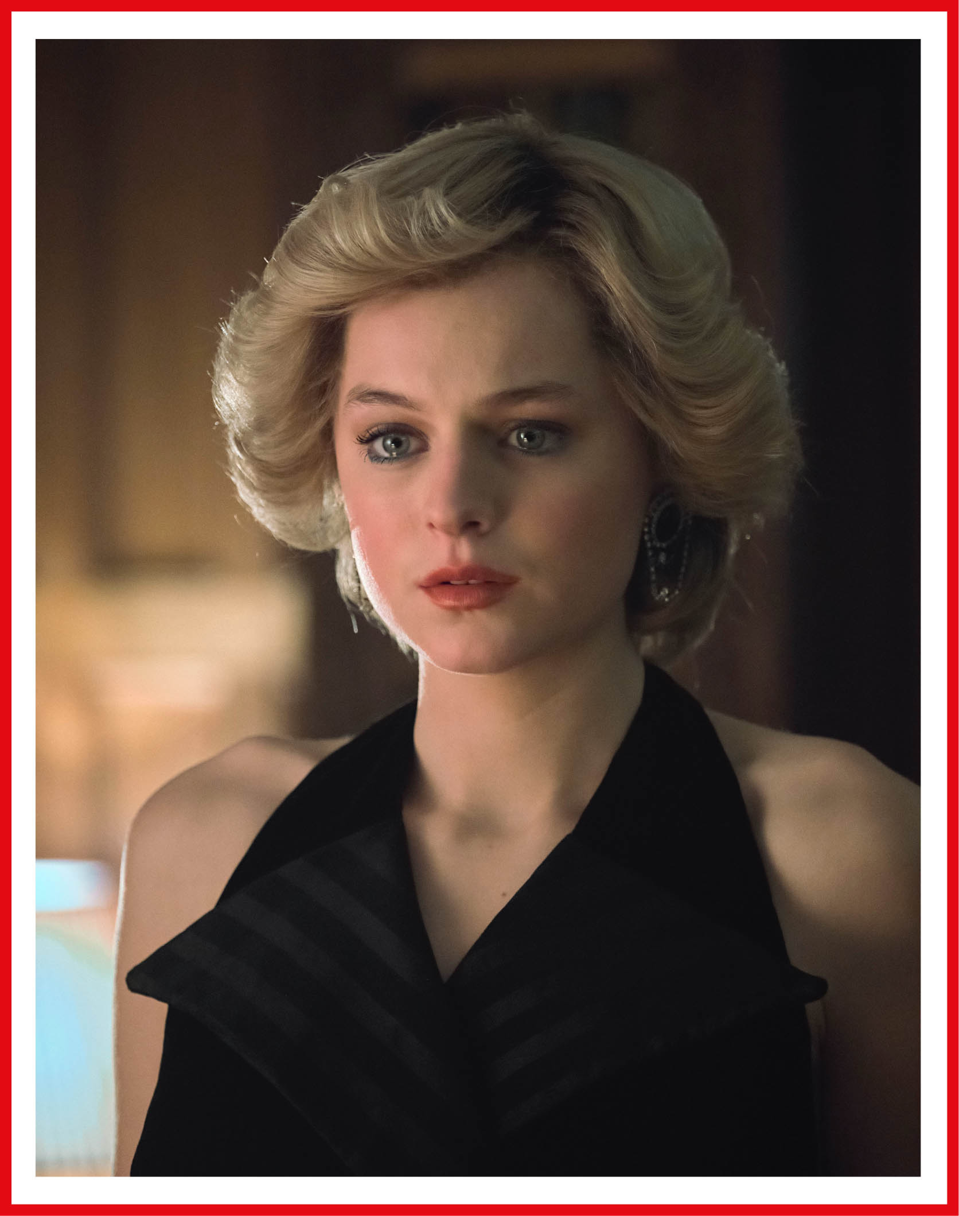 Emma Corrin as Princess Diana has a sweep of blonde hair and eyes framed in blue liner. For all the glamour, she looks troubled.