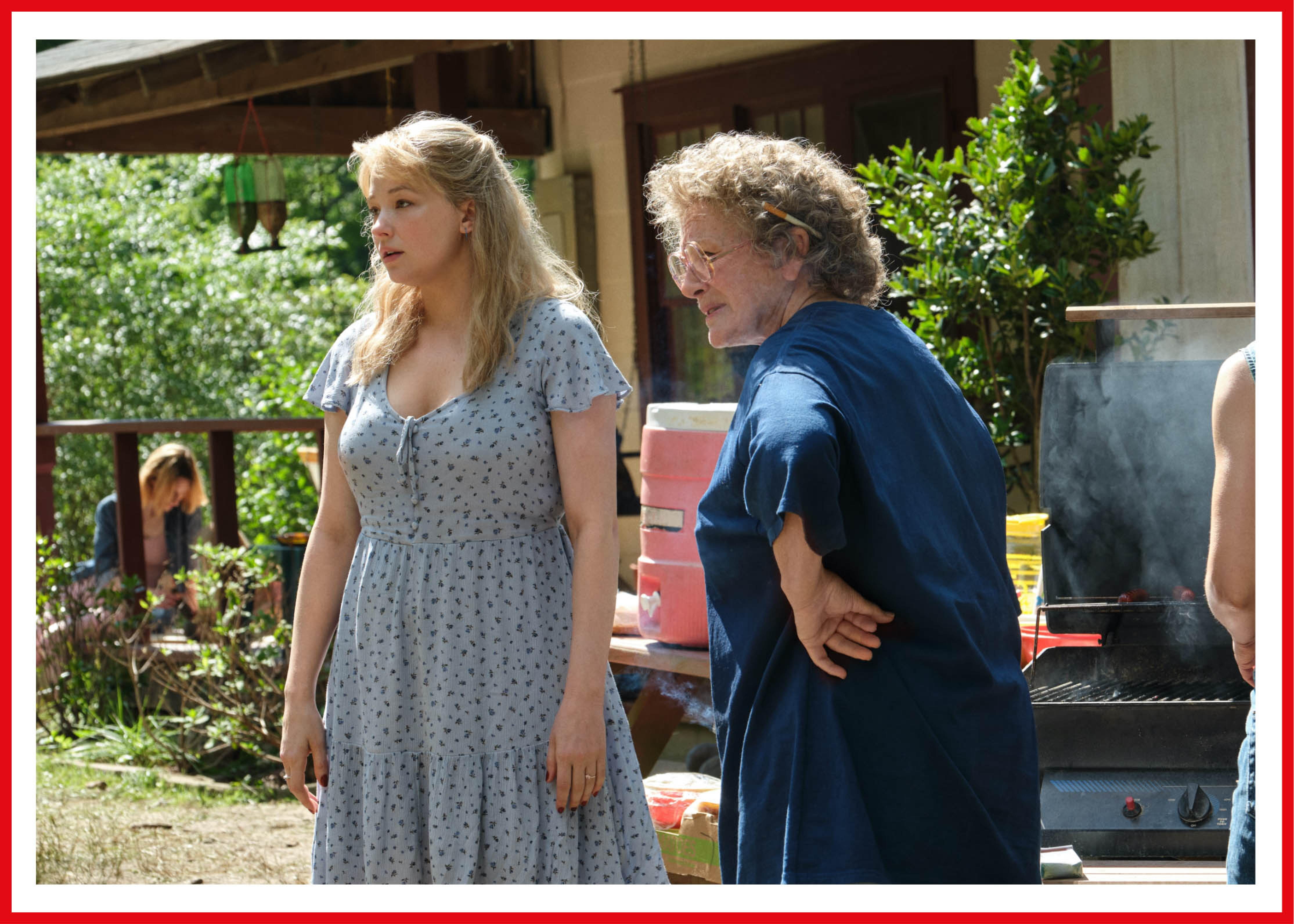 Haley Bennett as Lindsay Vance wears a blue babydoll dress that stands in contrast to the oversized t-shirt her co-star Glenn Close sports as Mamaw.