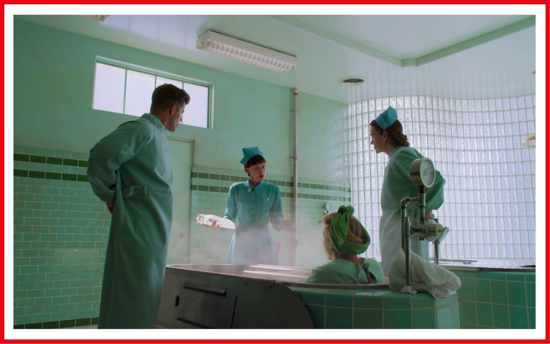 Between the tiled hospital walls and the actors' nurse costumes, it's green overload.