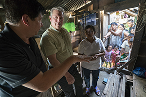 Al Gore with former Mayor of Tacloban City Alfred Romualdez and Typhoon Haiyan survivor Demi Raya, in the Raya family home; Tacloban City, Philippines, March 12, 2016 in An Inconvenient Sequel: Truth To Power from Paramount Pictures and Participant Media.Photo Credit: Jensen Walker