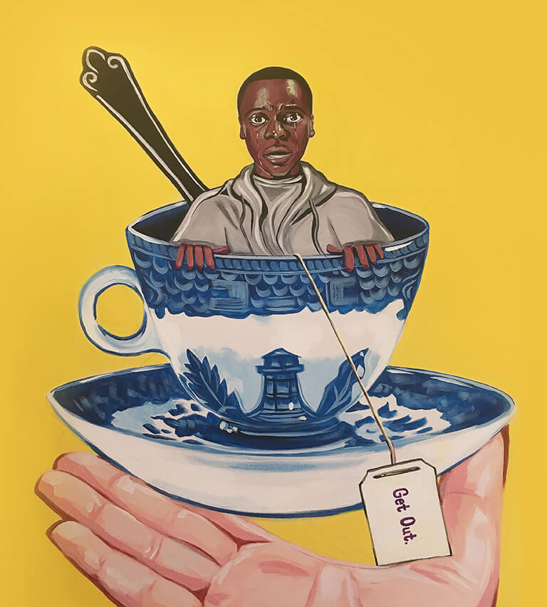 A miniature Chris is sitting, shocked, in a blue Georgian porcelain teacup on a bright yellow backdrop.