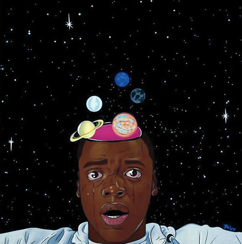 A crying Chris Washington looks past the camera as planets float out of his head into the backdrop of a starry space.