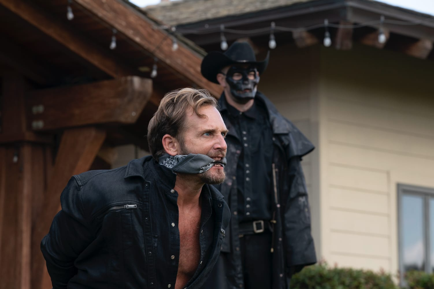 (from left) Dylan Tucker (Josh Lucas) and a Purger in *The Forever Purge*, directed by Everardo Gout. Photo Credit: Jake Giles Netter/Universal Pictures
